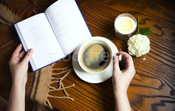 Coffee, book, plaid and candle at home. Food, hygge and comfort  Stock photo © dashapetrenko