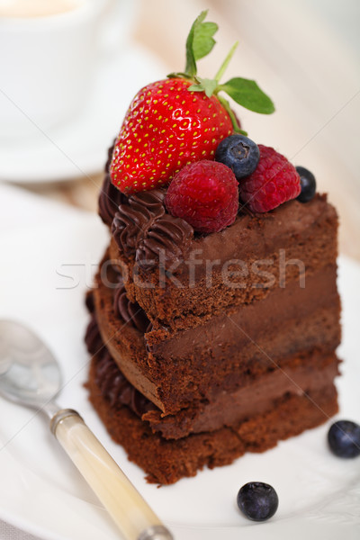 Piece of chocolate cake with icing and fresh berry  Stock photo © dashapetrenko