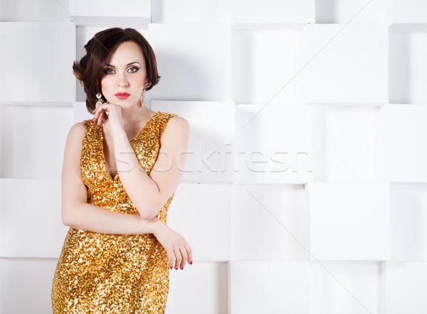 Superstar woman wearing golden shining dress Stock photo © dashapetrenko