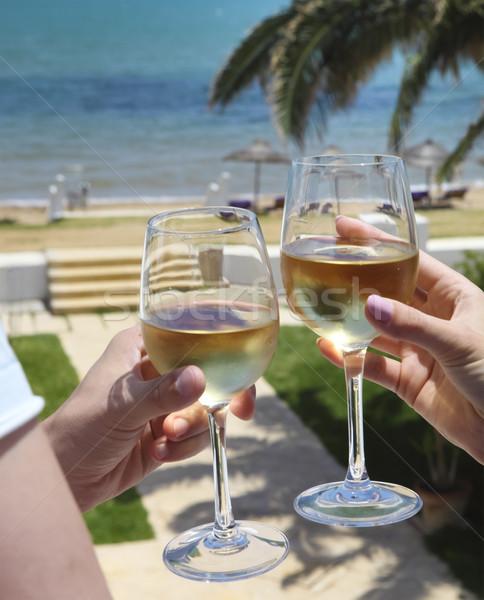 Man and woman clanging wine glasses  Stock photo © dashapetrenko