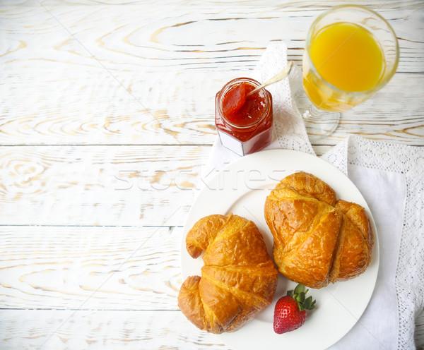 Kettő ízletes croissantok tányér eper lekvár Stock fotó © dashapetrenko