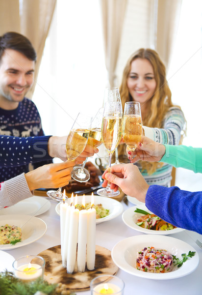 Friends toasting with champagne while having Christmas dinner Stock photo © dashapetrenko