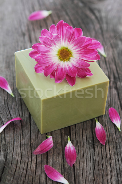 Bar of natural green soap with flower Stock photo © dashapetrenko