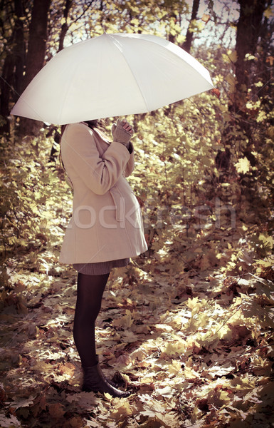 Young pregnant woman under umbrella  Stock photo © dashapetrenko