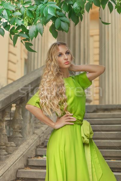 Belle blond femme longtemps vert robe Photo stock © dashapetrenko