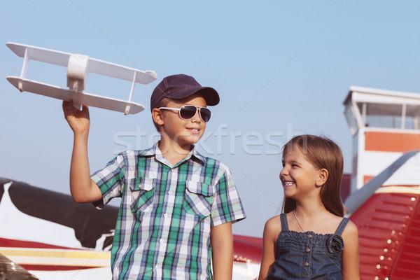 Little boy and little girl pilot with handmade plane  Stock photo © dashapetrenko
