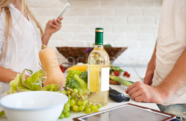 Young couple cutting vegetables at the kitchen Stock photo © dashapetrenko