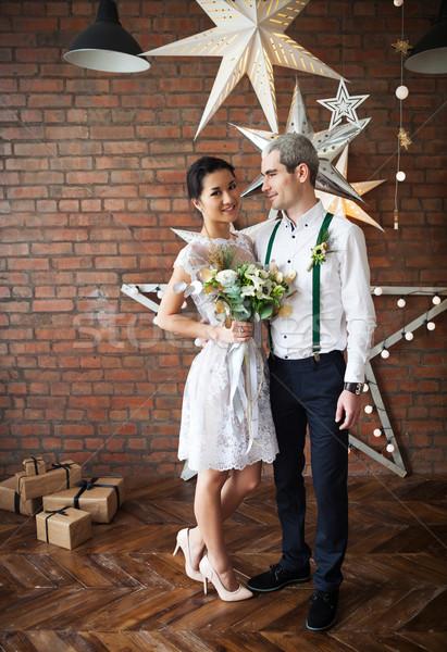Cheerful married couple dancing near the brick wall  Stock photo © dashapetrenko