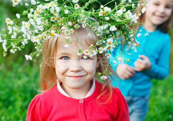 Portrait of two little sisters outdoors wearing wreath from whit Stock photo © dashapetrenko