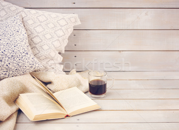 Stock photo: Cozy still life with book, coffee, pillows and plaid