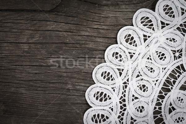 Lace on the wooden background Stock photo © dashapetrenko