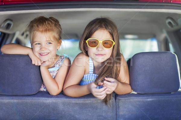 Happy kids in the car. Family on vacation Stock photo © dashapetrenko