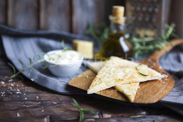 Stock photo: Focaccia with olive oil, parmesan cheese, white sause and rosema