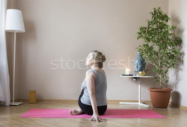 Middle aged woman doing yoga indoors Stock photo © dashapetrenko