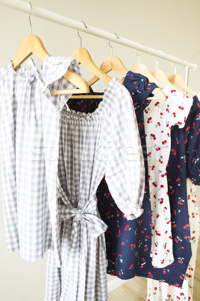 Cloth Hangers with dresses. Women's  clothes.  Stock photo © dashapetrenko