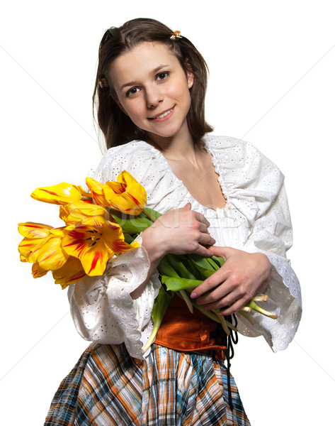 Hermosa sonriendo chica de campo tulipán flores flor Foto stock © dashapetrenko