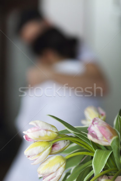Young couple kisses and hugs at kitchen in the morning Stock photo © dashapetrenko