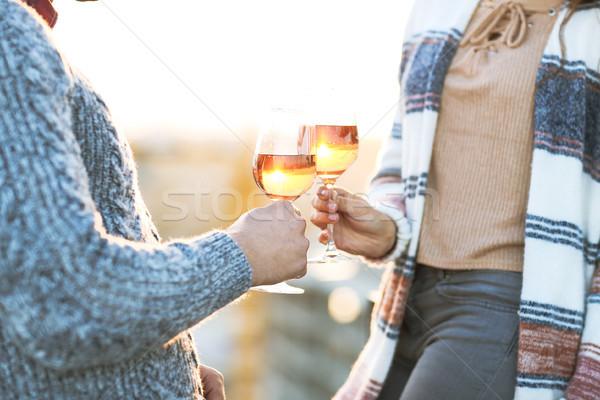 Férfi nő borospoharak kint üveg rózsa Stock fotó © dashapetrenko