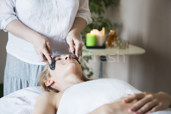 Young woman have face treatment at beauty clinic Stock photo © dashapetrenko