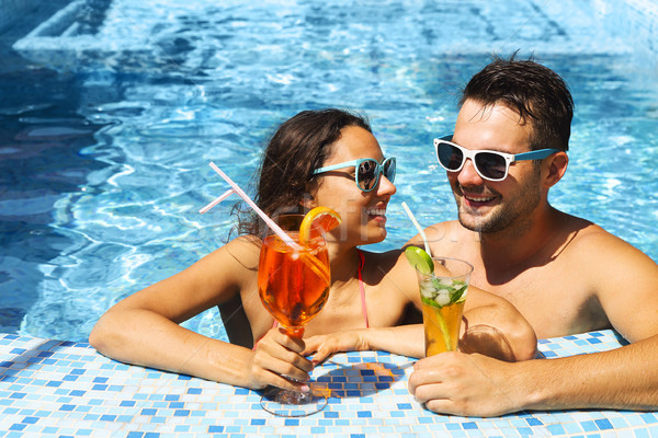 Young couple are relaxing in swimming pool Stock photo © dashapetrenko