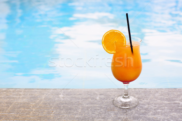 Glass of tropical cocktail on poolside Stock photo © dashapetrenko