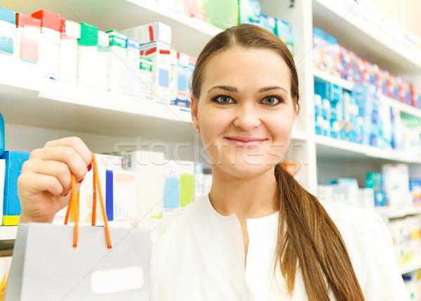 Closeup of a female pharmacist holding packet at drugstore Stock photo © dashapetrenko