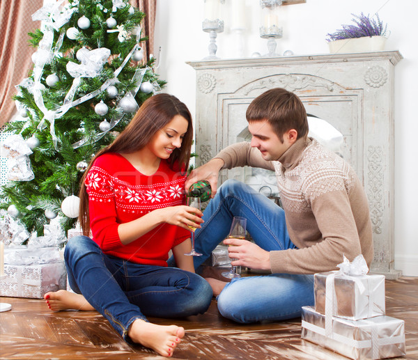 Young happy smiling couple by the Cristmas tree Stock photo © dashapetrenko