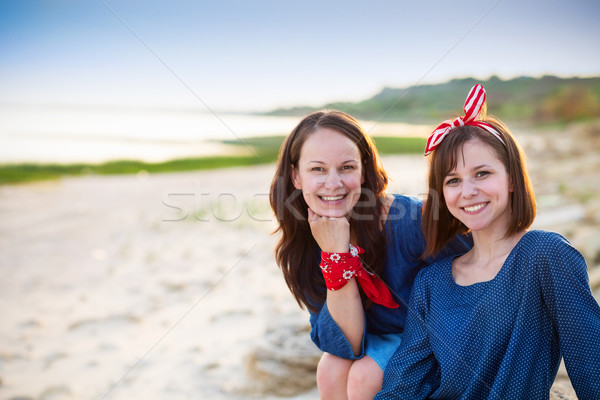 Portrait of a mother and her teen daughter on the beach Stock photo © dashapetrenko
