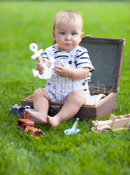 Portrait of the smiling baby boy playing outdoors Stock photo © dashapetrenko