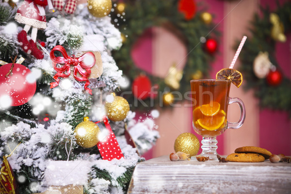 Hot winter tea with spices on a rustic table  Stock photo © dashapetrenko