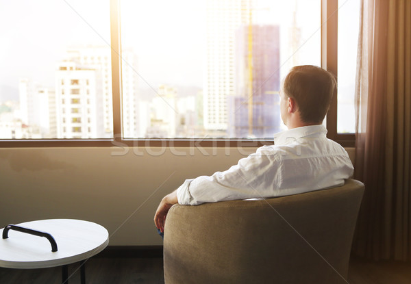 Rear view of man relaxing on chair in the room Stock photo © dashapetrenko