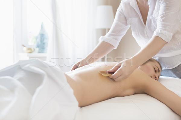 Young woman take back treatment at health spa Stock photo © dashapetrenko