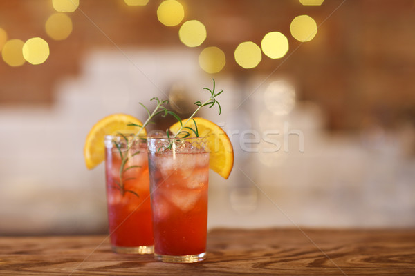 Two cocktail glasses on wooden bar counter Stock photo © dashapetrenko