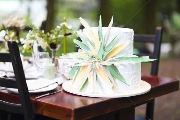 Gyönyörű esküvői torta virág asztal kint virágok Stock fotó © dashapetrenko