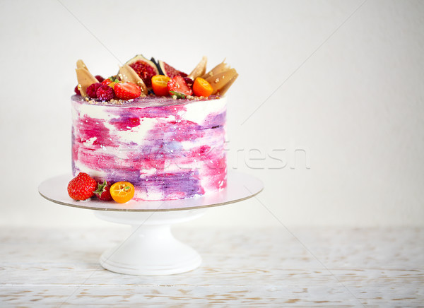 Beautiful bright cake on a porcelain cake stand decorated with f Stock photo © dashapetrenko