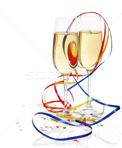 Champagne in two glasses with streamers Stock photo © dashapetrenko