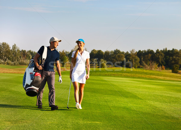 Young sportive couple playing golf  Stock photo © dashapetrenko