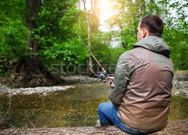 Fisherman with fly-fishing on mountain river Stock photo © dashapetrenko