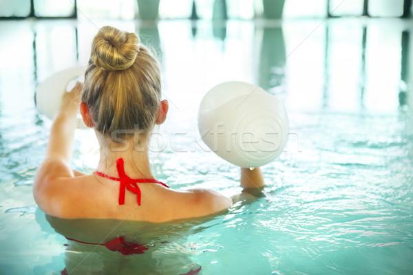 Sarışın genç kadın su aerobik dambıl yüzme Stok fotoğraf © dashapetrenko