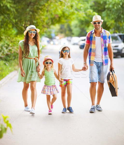 Happy young family walking with guitar spending carefree time to Stock photo © dashapetrenko