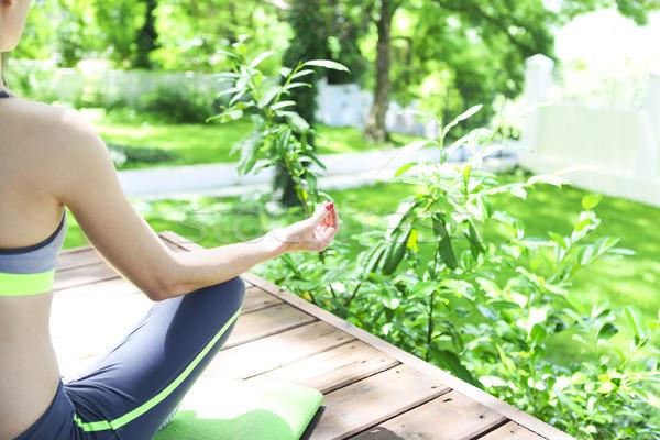 Young woman doing yoga asana in the moning outdoors  Stock photo © dashapetrenko
