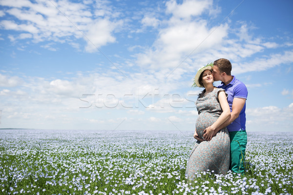 Young happy beautiful pregnant couple in linen field Stock photo © dashapetrenko