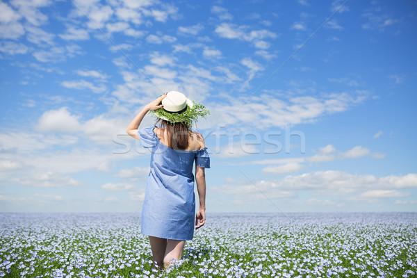 Young beautiful woman in linen field Stock photo © dashapetrenko
