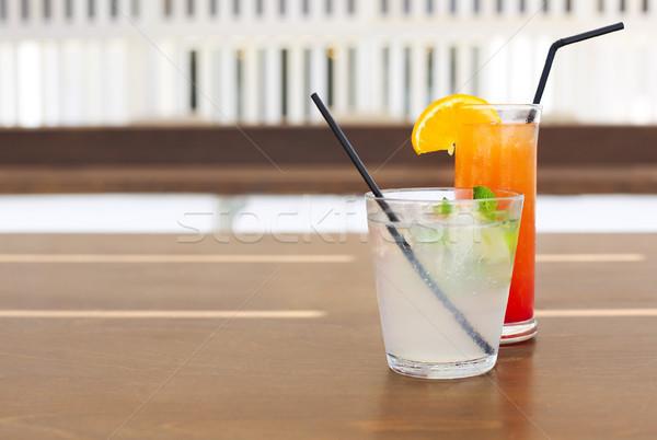 Cocktail glasses on wooden background Stock photo © dashapetrenko