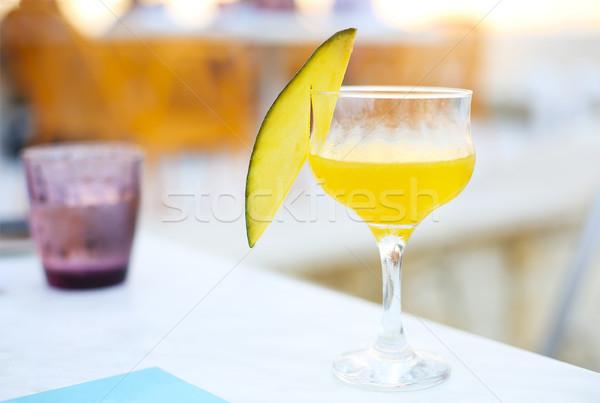 Glass of mango cocktail on bar counter  Stock photo © dashapetrenko