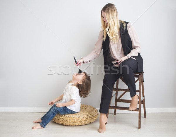 Mother and daughter doing make up oto each other Stock photo © dashapetrenko