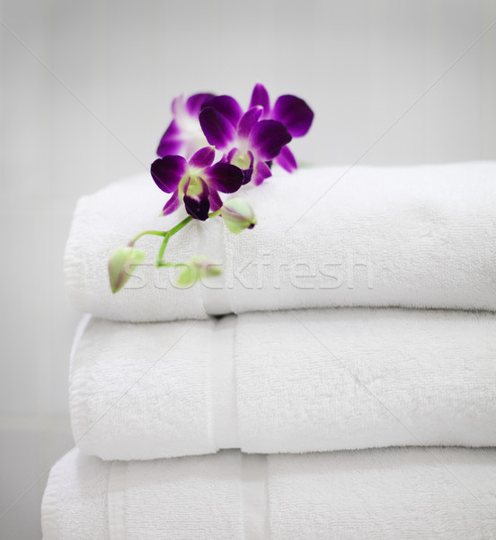 Purple orchid on white towels Stock photo © dashapetrenko