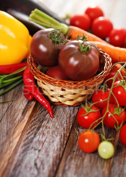 Vegetables still life in wooden background Stock photo © dashapetrenko