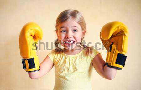 Portrait fille jaune gants de boxe émotionnel femme Photo stock © dashapetrenko