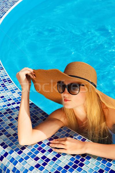 Woman in a hat enjoying a swimming pool Stock photo © dashapetrenko